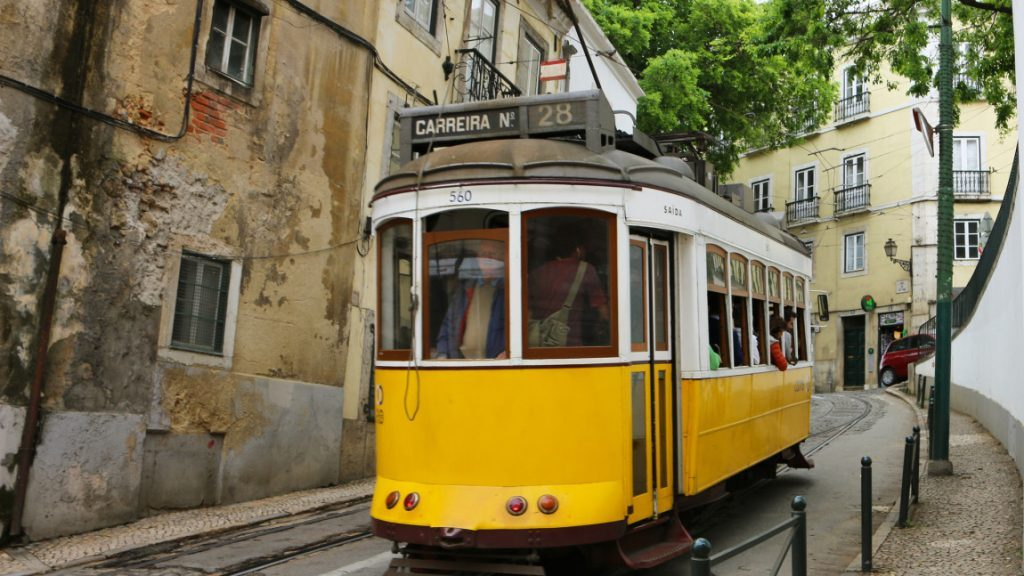 Yellow tram 28 in the streets of Alfama, Lisbon