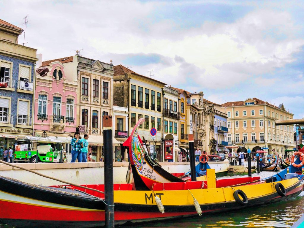 The main canal of Aveiro with some Moliceiros or traditional boats, Portugal