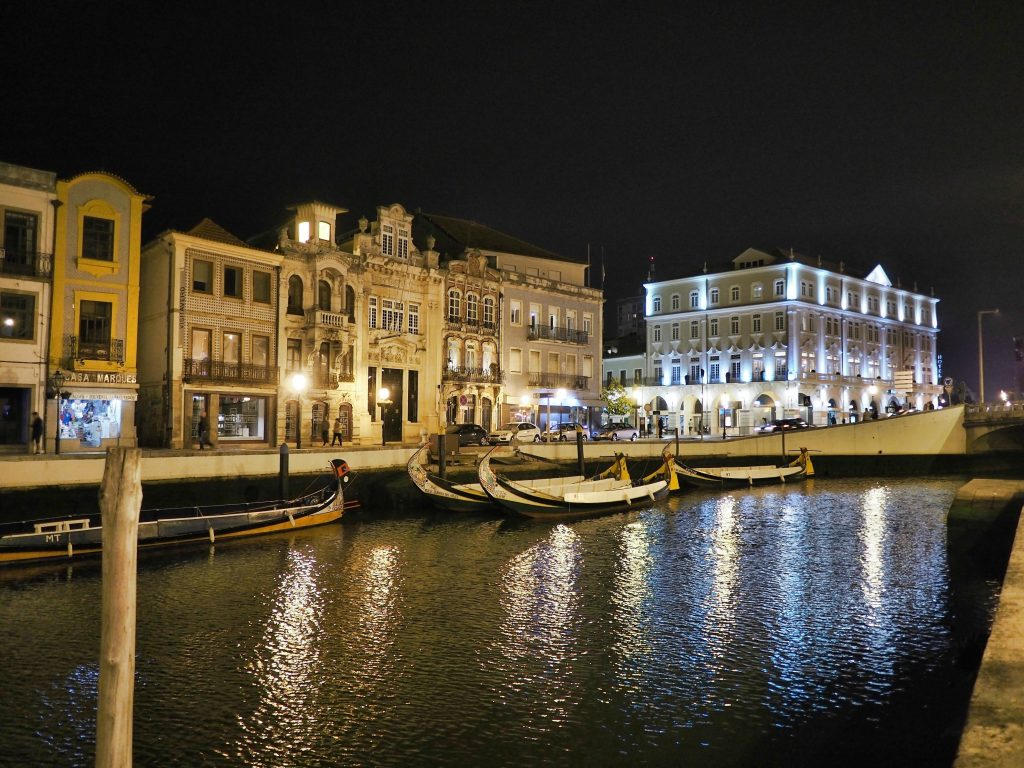 Night view of the main canal of Aveiro with some Moliceiros or traditional boats, Portugal
