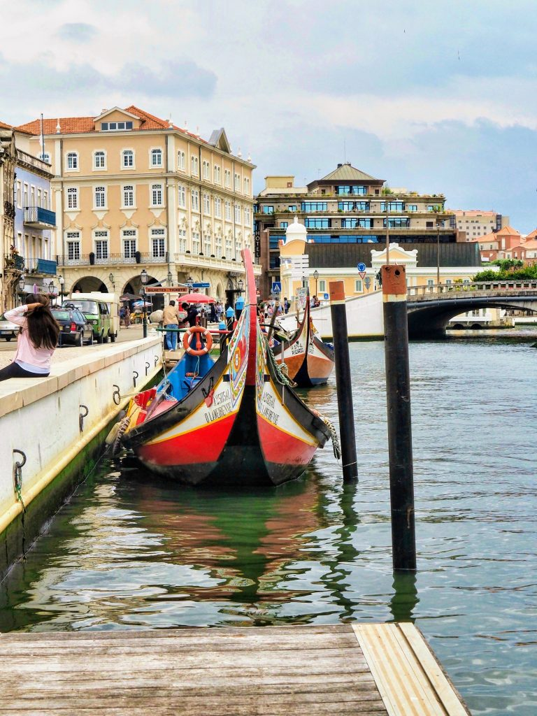 The main canal of Aveiro with a Moliceiro or traditional boat, Portugal