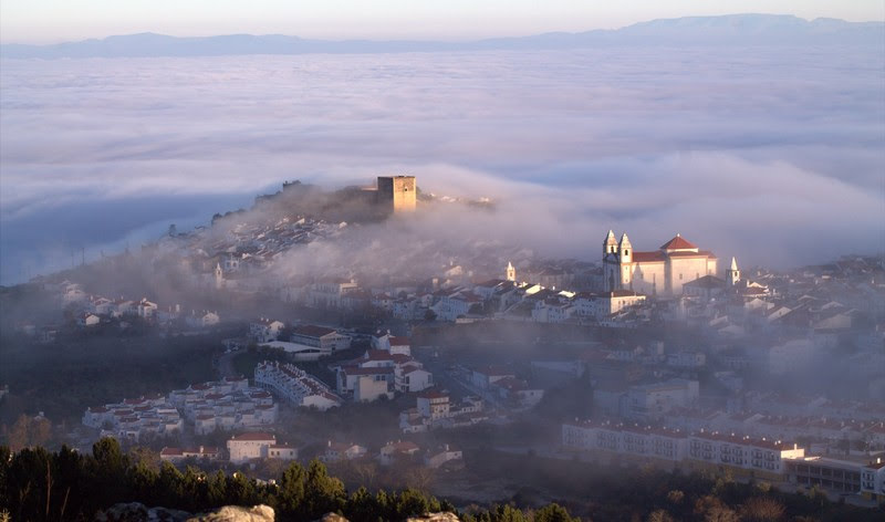 A view from far to Castelo de Vide small town on a misty and cloudy day