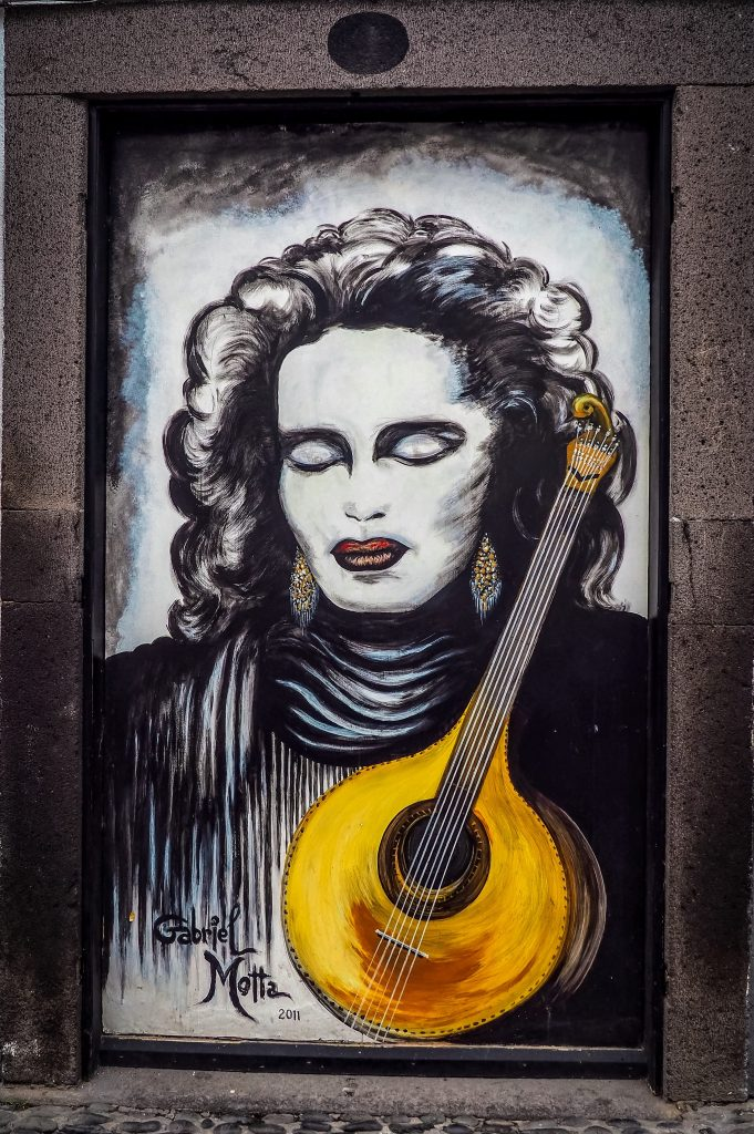 Painting of a woman with guitar