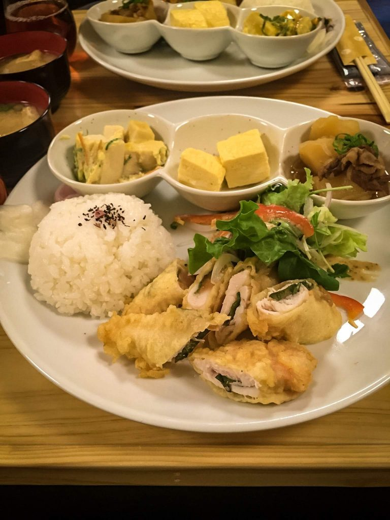 miso soup, a ginormous plate of rice, chicken tempura, green salad, boiled eggs