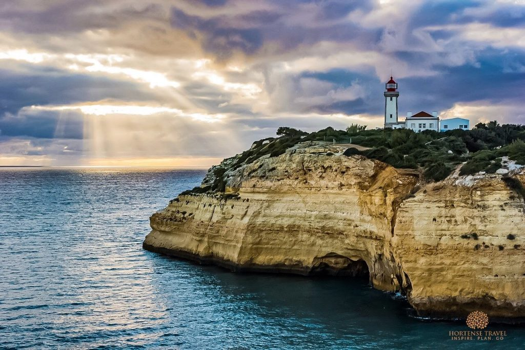 A beautiful cliff and a lighthouse in the Algarve, Portugal