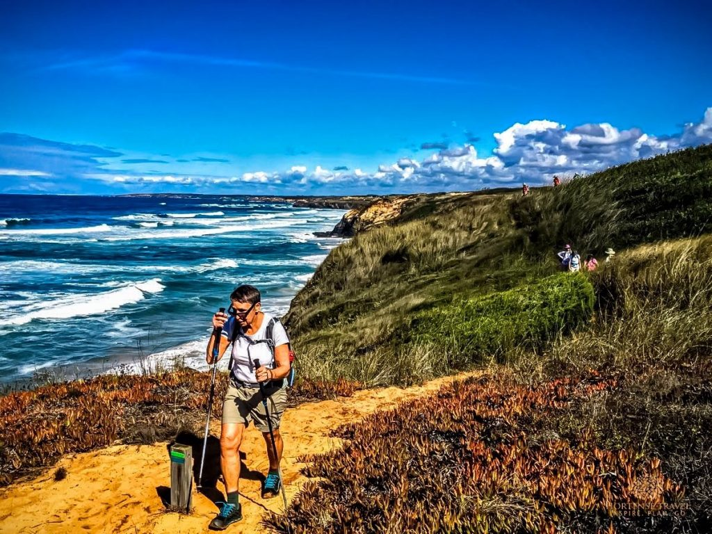 A woman is hiking the Costa da Vicentina trail in Portugal