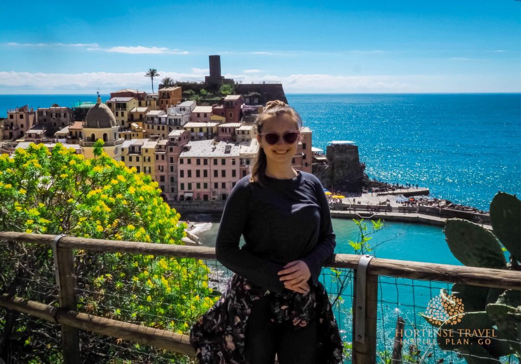 A girl posing in front of Vernazza village, Cinque Terre