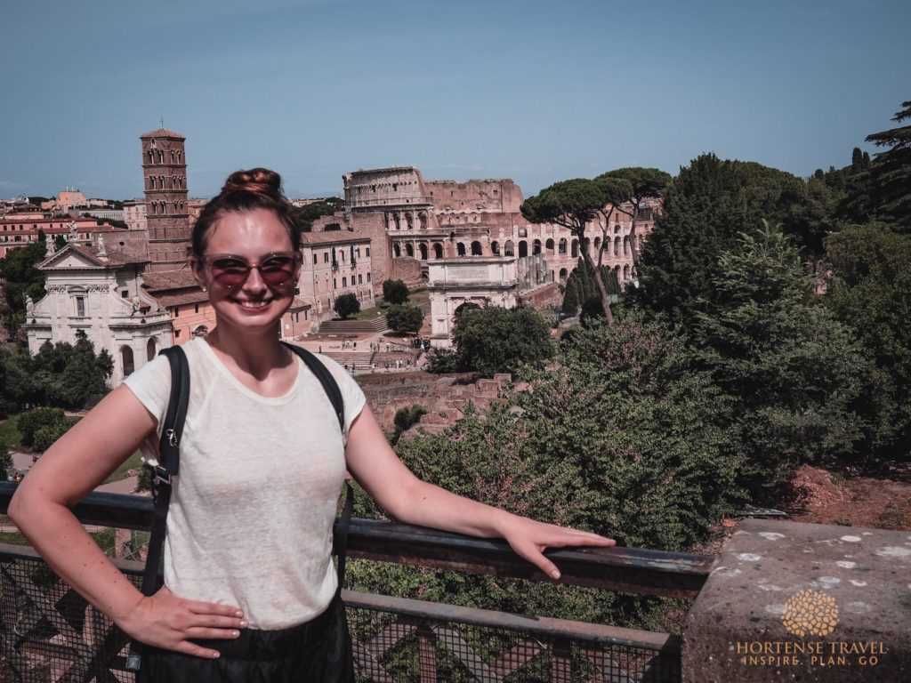 A girl overlooking the Colosseum in Monti, Rome